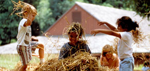 Children in playing in hay