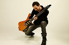 Photo of Paul Gilbert with Guitar