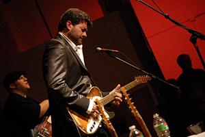 Tab Benoit on stage playing guitar