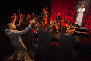 Ahamefule J. Oluo on stage with orchestra