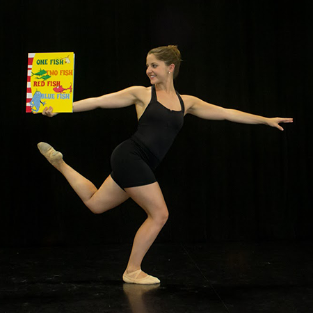 Dancer on stage with a Dr. Seuss book