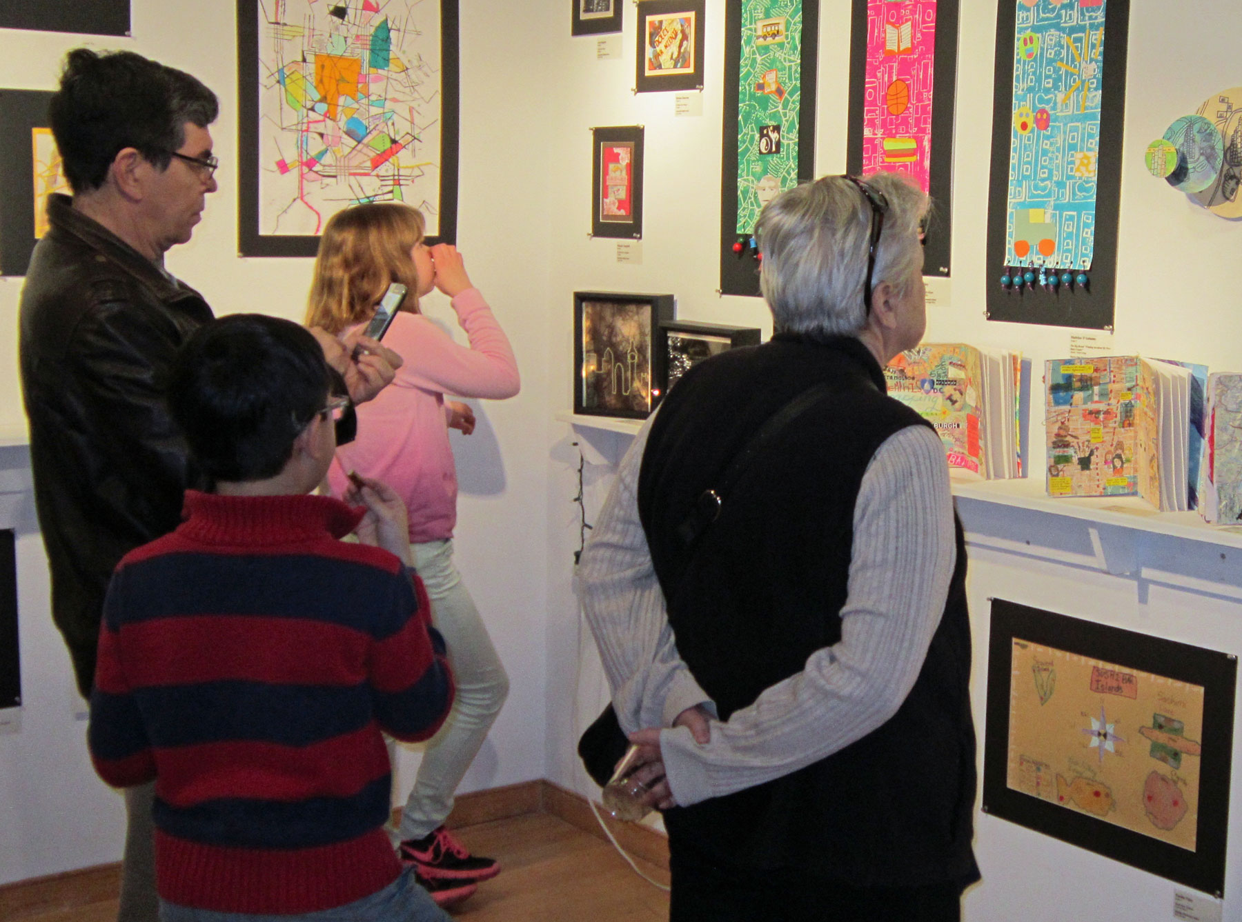 Guests enjoy a Youth Art Month exhibit