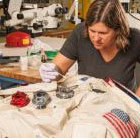Photo of conservator working on Neil Armstrong's spacesuit