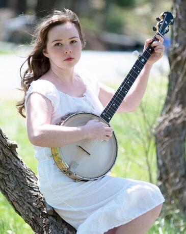 Lydia Sylvia Martin with instrument.