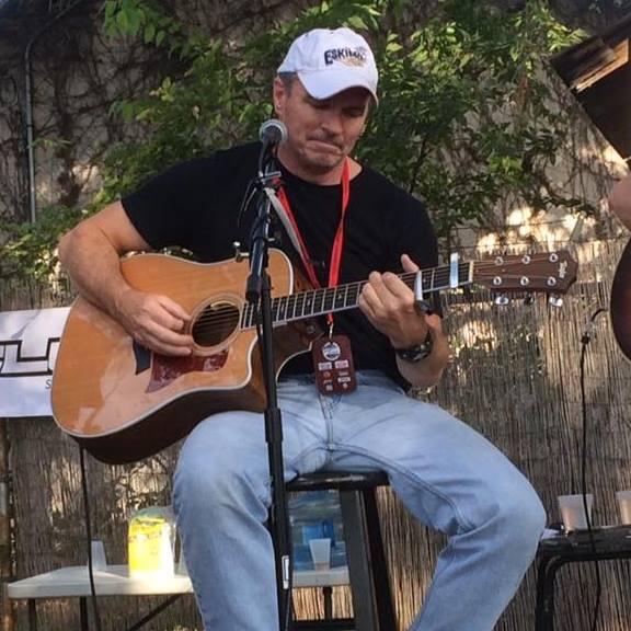 Mike Ryan playing guitar