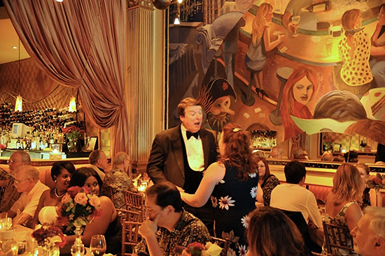 Opera performers sing arias to diners.