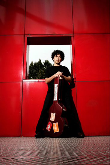 Judicael Perroy stands with his guitar
