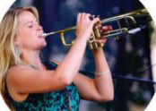 Photo of Bria Skonberg playing trumpet