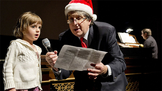 Young singer sings on stage at Weinberg Winterfest