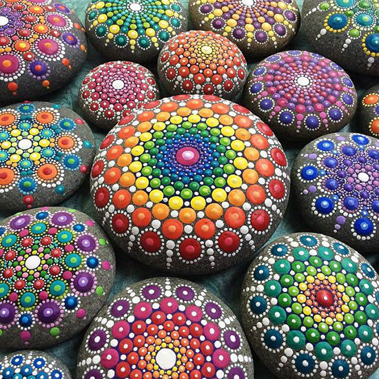 beautifully decorated and colorful mandala stones