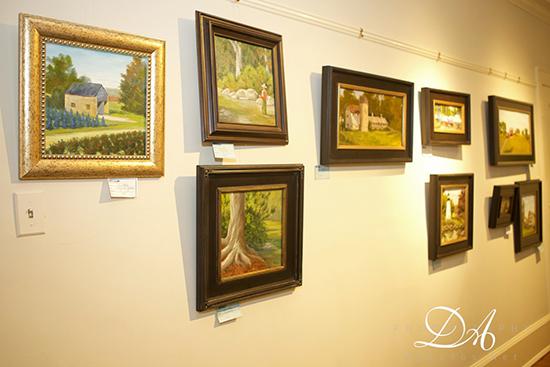 Plein Air Festival Paintings hang on gallery wall