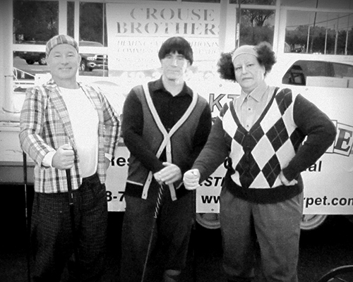 Halloween parade judges dressed as the Three Stooges