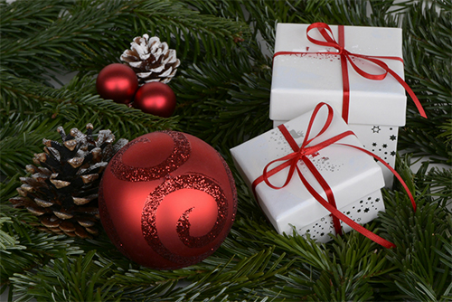 photo of holiday gifts and greenery