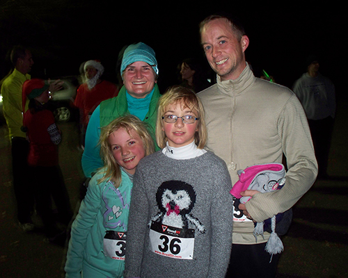 family of runners at the Santa Chase