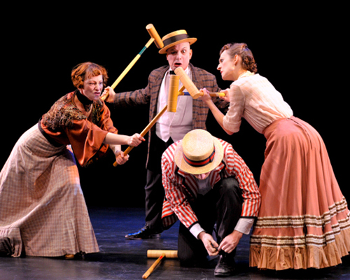 Four actors in old fashioned garb weilding croquet sticks
