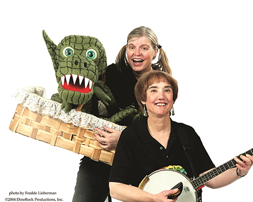 Puppeteers with puppets and musical instruments.