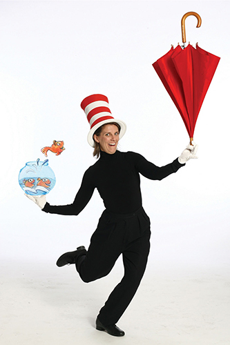 Actor as Cat in the Hat with red umbrella
