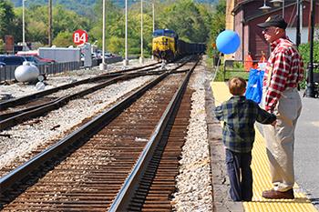 Man and small boy at Brunswick Crossing