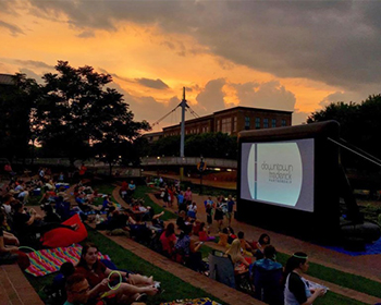 Crowd Gathers for Movie Night