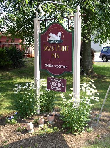Swan Point Inn sign