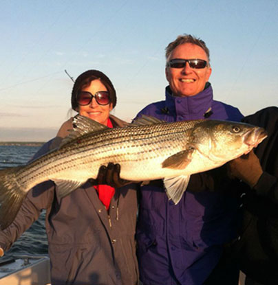 Two charter customers proudly show their catch.