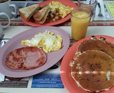 Pancakes, Eggs, ham and juice.