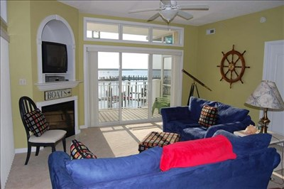 Condo living space has a nautical feel.