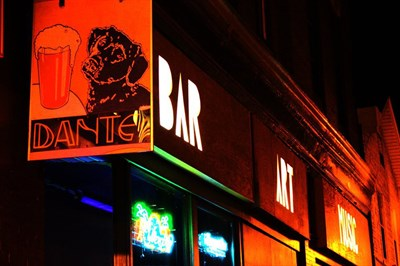 Dant's Bar, Art, Music sign lights up the night.