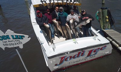 Picture of fishing party holding up their catch of Rockfish aboard the Jodi Lee -