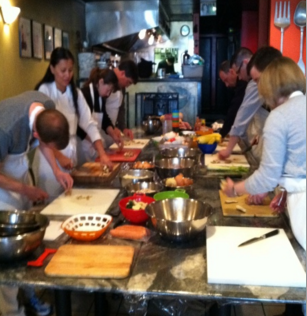 People cooking at Pierpoint Cooking Class.