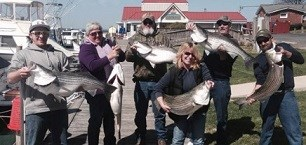 People holding up good looking fishes