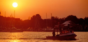 Photo of boats on the water at sunset