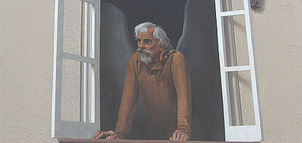 Mural of man looking out window