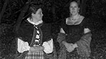 Two ladies dressed as if from the past appear in the dark at Steppingstone