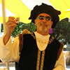 Photo of Columbus re-enactor toasting the day