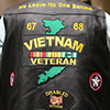 A Vietnam Veteran wearing a colorful leather vest