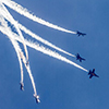 Blue Angels fly against a stunning blue sky