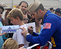 Blue Angel signs autograph at Martin State Airport