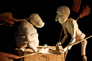 Marionettes perform the story of humanity