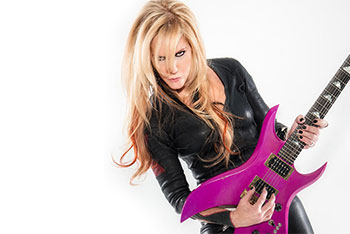 Lita Ford with her hot pink guitar