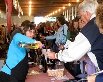 Photo of people enjoying art & wine