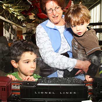 A family looks at trains at the aviation museum