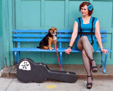 Erin Harpe with Guitar Case and dog