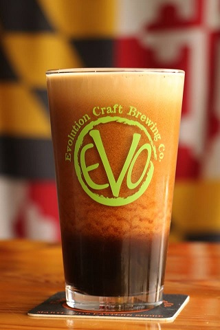 glass of beer with Evo's logo
