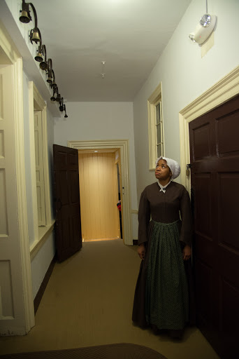 Ranger Anokwale looking at Hampton mansion servants' bells