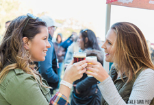 Women enjoy locally brewed beers at festival.