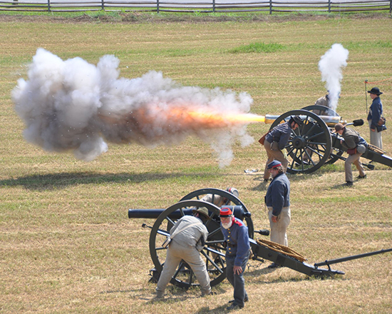 Civil War reenactors conduct artillery drills