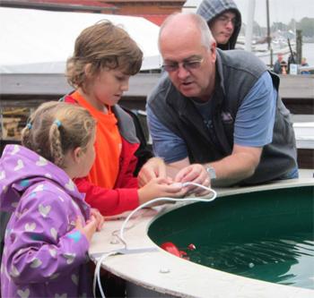 Lab tours, aquatic animal touch tank, lab tours, games, prizes