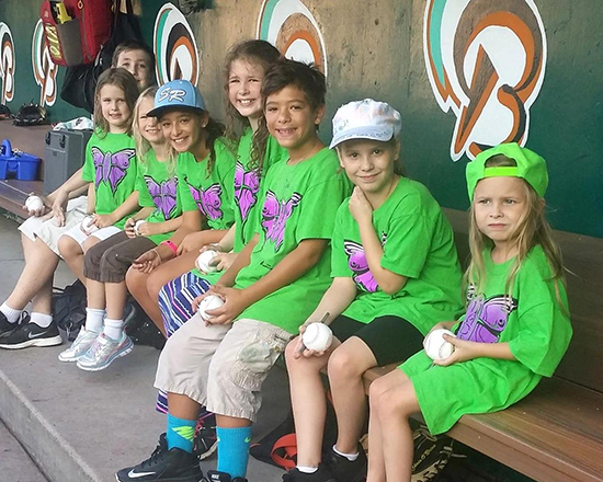Children in the Bowie Baysox dugout.