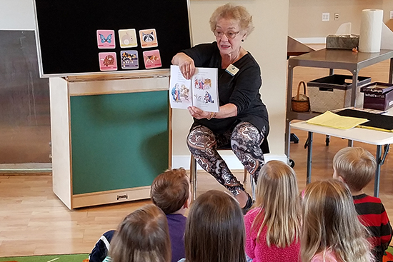 Teacher shares stories with preschoolers